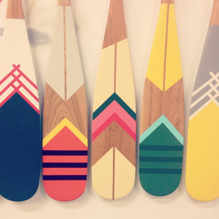 painted wooden paddles
